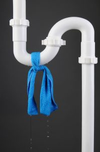 white-pipe-with-blue-cloth-tied-around-leak