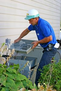 technician-working-on-outdoor-ac-unit