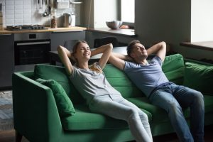 couple-relaxing-on-sofa