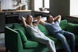 couple-relaxing-on-sofa