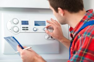 technician-adjusting-knobs-on-gas-boiler