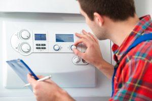 technician-adjusting-knobs-on-gas-boiler