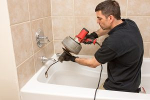 plumber-cleaning-drain-with-drain-snake