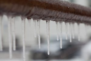 brown-pipe-with-icicles-dripping