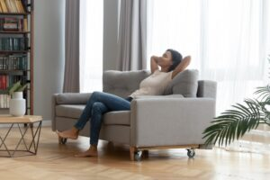 woman-leaning-back-on-couch-looking-comfortable