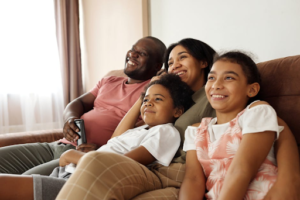 happy-family-sitting-on-couch