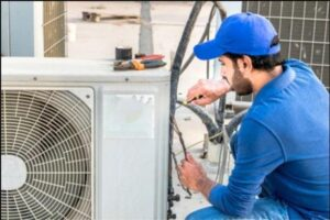 technician-working-on-air-conditioner