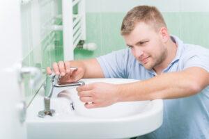 plumber-working-on-sink